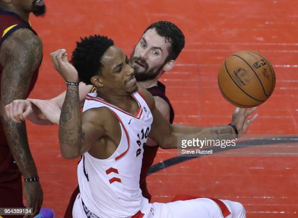 TORONTO ON MAY 3 Cleveland Cavaliers center Kevin Love knocks the ball away from Toronto Raptors guard DeMar DeRozan as the Toronto Raptors lose game...