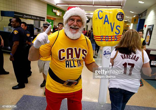 Cleveland Cavaliers fan dressed as Santa Claus holds an inflatable broom before Game Four of the Eastern Conference Finals against the Atlanta Hawks...