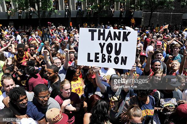 Cleveland Cavaliers fans celebrate and hold up a sign during the Cleveland Cavaliers Victory Parade And Rally on June 22 2016 in downtown Cleveland...