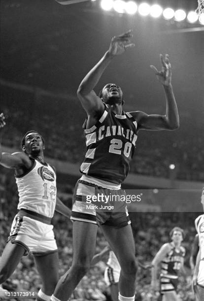 Cleveland Cavaliers forward Campy Russell goes up for a rebound in front of Denver Nuggets guard Ted McClain during an NBA basketball game at...