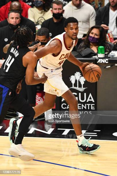 Cleveland Cavaliers Forward Evan Mobley dribbles around Los Angeles Clippers Forward Terance Mann during a NBA game between the Cleveland Cavaliers...