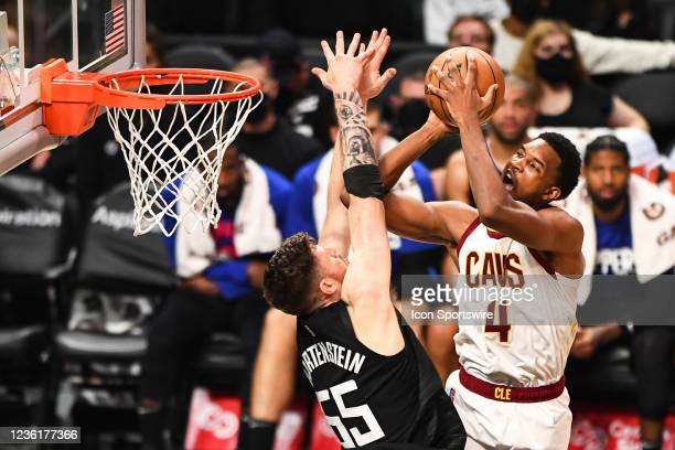 Cleveland Cavaliers Forward Evan Mobley tries to score over Los Angeles Clippers Center Isaiah Hartenstein during a NBA game between the Cleveland...