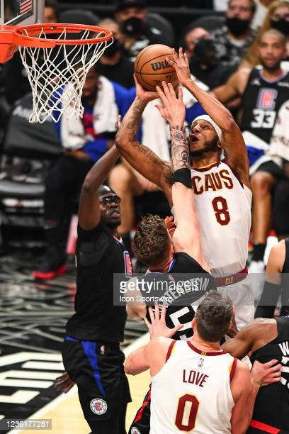 Cleveland Cavaliers Forward Lamar Stevens goes up for a shot inside against Los Angeles Clippers Center Isaiah Hartenstein and Los Angeles Clippers...