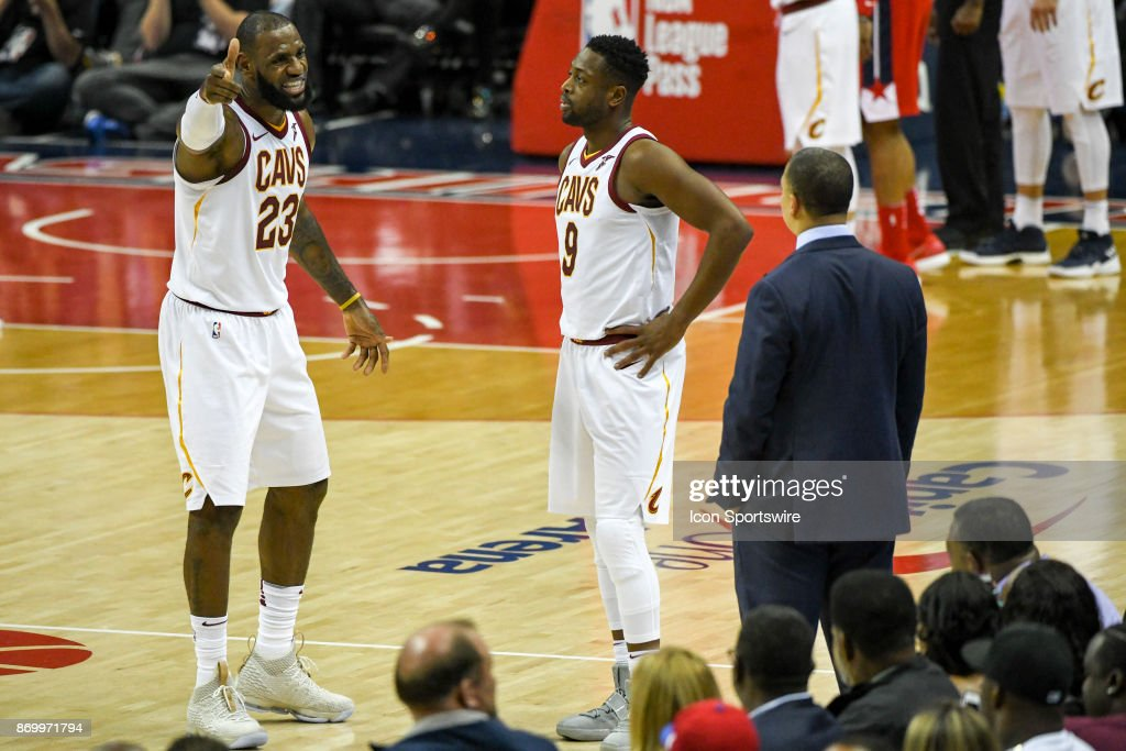 Cleveland Cavaliers forward LeBron James (23) has words with head coach Tyronn Lue as guard Dwyane Wade (9) looks on on November 3, 2017 at the Capital One Arena in Washington, D.C.