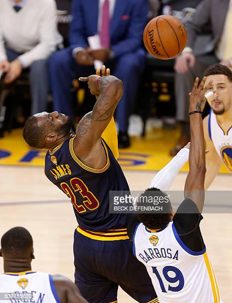 Cleveland Cavaliers forward LeBron James is stripped of the ball by Golden State Warriors guard Leandro Barbosa during the second quarter of game 1...