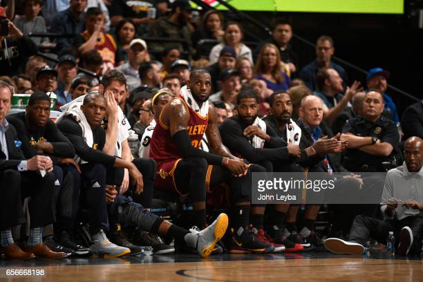 Cleveland Cavaliers forward LeBron James looks on from the bench during the fourth quarter on March 22 2017 in Denver Colorado at Pepsi Center The...