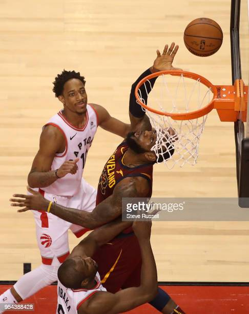 TORONTO ON MAY 3 Cleveland Cavaliers forward LeBron James tries to bank the shot in off the glass as Toronto Raptors guard DeMar DeRozan looks on as...