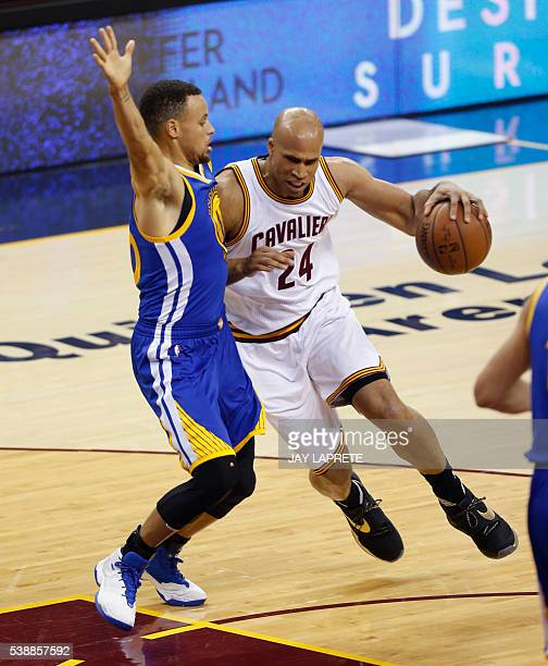Cleveland Cavaliers forward Richard Jefferson drives to the bakset against Golden State Warriors guard Stephen Curry during Game 3 of the NBA Finals...