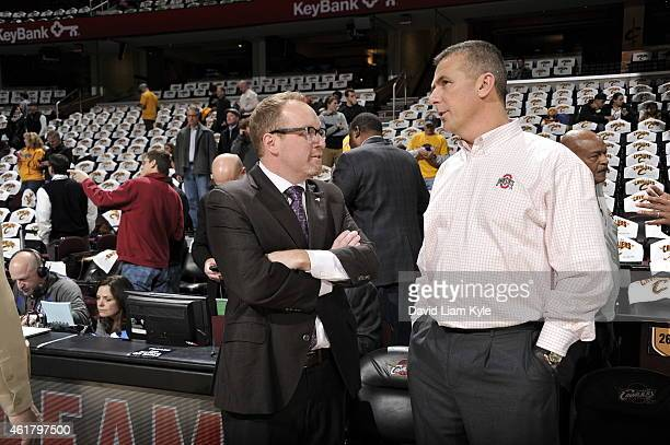 Cleveland Cavaliers General Manager David Griffin speaks with head football coach of the Ohio State Buckeyes Urban Meyer before the game between the...