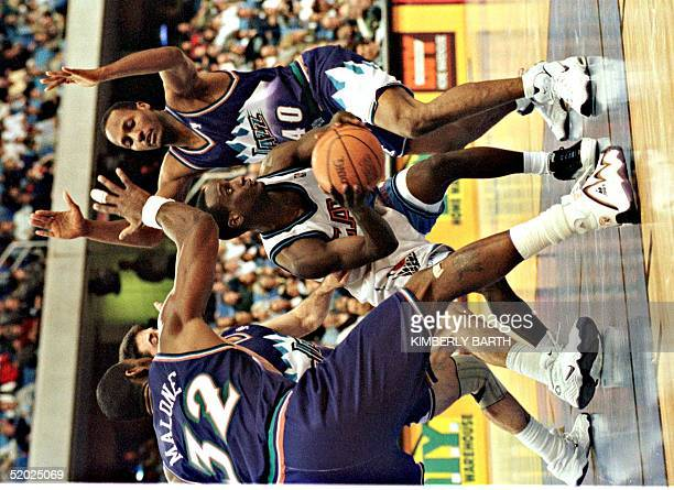 Cleveland Cavaliers guard Brevin Knight is surrounded by Utah Jazz defenders Karl Malone John Stockton and Shandon Anderson in the final minutes of...