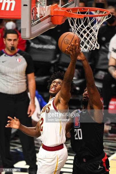 Cleveland Cavaliers Guard Collin Sexton scores over Los Angeles Clippers Forward Justise Winslow during a NBA game between the Cleveland Cavaliers...