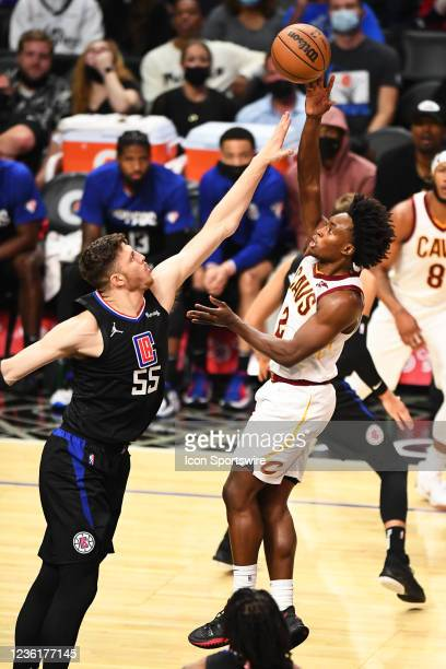 Cleveland Cavaliers Guard Collin Sexton shoots over Los Angeles Clippers Center Isaiah Hartenstein during a NBA game between the Cleveland Cavaliers...
