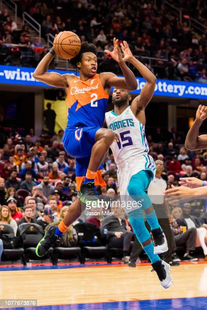Cleveland Cavaliers guard Collin Sexton shoots while under pressure from Charlotte Hornets guard Kemba Walker during the second half at Quicken Loans...