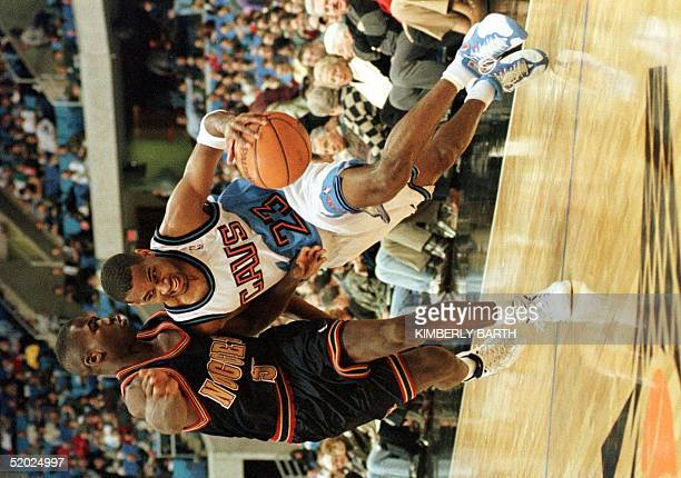 Cleveland Cavaliers guard Derek Anderson drives to the basket around Denver Nuggets Anthony Goldwire 10 December at Gund Arena in Cleveland, OH. The...