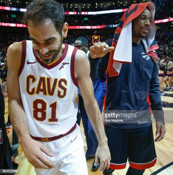Cleveland Cavaliers guard Jose Calderon and Toronto Raptors guard DeMar DeRozan say goodbye to each other following the game Toronto Raptors vs...