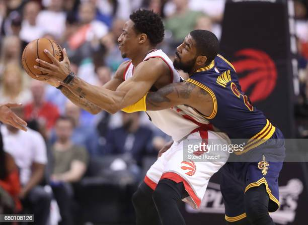 TORONTO MAY 7 Cleveland Cavaliers guard Kyrie Irving defends Toronto Raptors guard DeMar DeRozan as the Toronto Raptors lose the Cleveland Cavaliers...