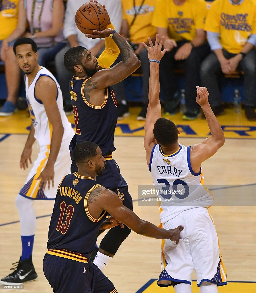 Cleveland Cavaliers Guard Kyrie Irving Shoots The Ball