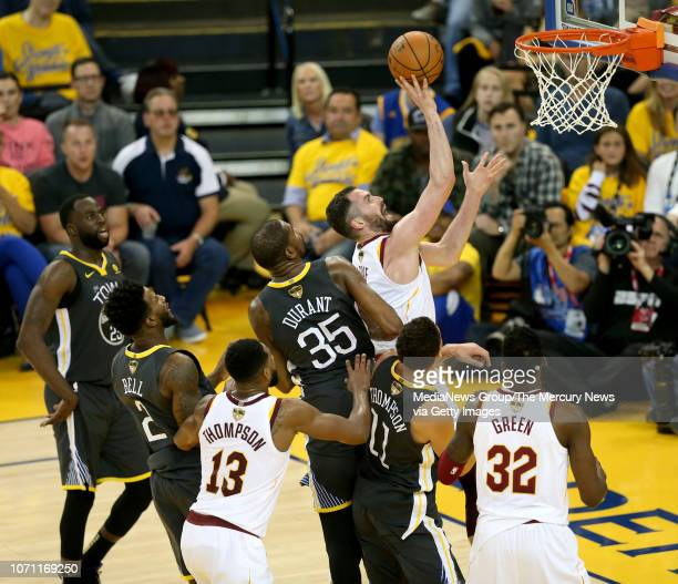 Cleveland Cavaliers' Kevin Love shoots past Golden State Warriors' Kevin Durant during the third quarter of Game 2 of the NBA Finals at Oracle Arena...