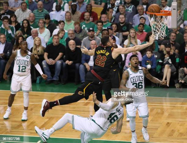 Cleveland Cavaliers Larry Nance Jr is called for an offensive foul as he knocks over Boston Celtics Aron Baynes during fourth quarter action The...