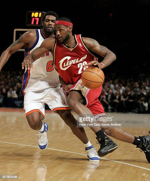 Cleveland Cavaliers' LeBron James drives down court past New York Knicks' Qyntel Woods during a game at Madison Square Garden. The Knicks won, 96-94.