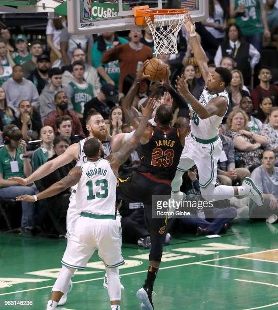 Cleveland Cavaliers Lebron James drives to the basket with pressure from Boston Celtics players Marcus Morris Aron Baynes and Marus Smart during...