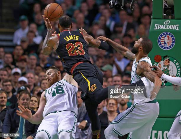 Cleveland Cavaliers' LeBron James drives to the hoop as Boston Celtics Aron Baynes and Marcus Morris defend in the first house The Boston Celtics...