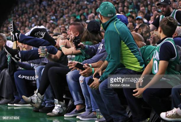 Cleveland Cavaliers' LeBron James goes flying into the crowd during a first quarter loose ball chase The Boston Celtics hosted the Cleveland...