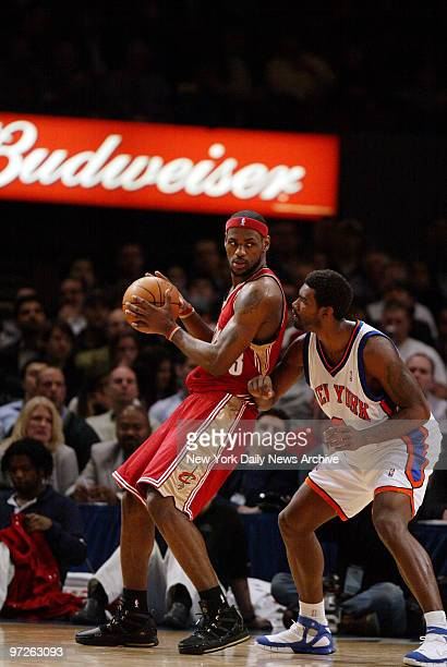 Cleveland Cavaliers' Lebron James is defended by New York Knicks' Qyntel Woods during a game at Madison Square Garden. The Knicks won, 96-94.