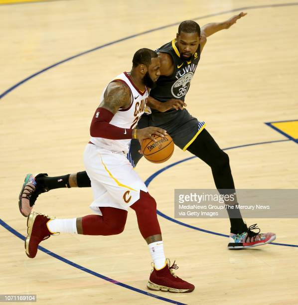 Cleveland Cavaliers' LeBron James is guarded by Golden State Warriors' Kevin Durant during the third quarter of Game 2 of the NBA Finals at Oracle...