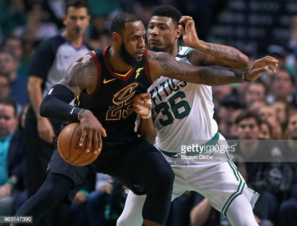 Cleveland Cavaliers' LeBron James is guarded by the Celtics Marcus Smart in the first half The Boston Celtics hosted the Cleveland Cavaliers for Game...