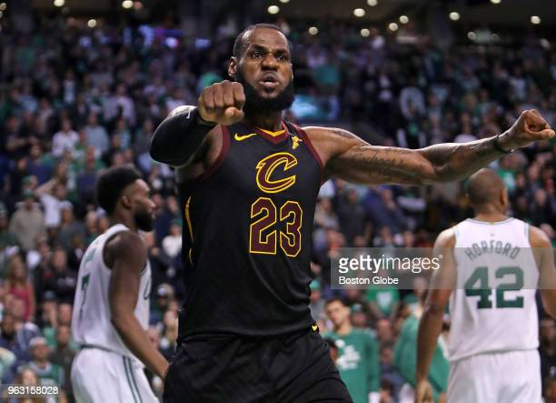 Cleveland Cavaliers LeBron James reacts after he was credited with two points on a drive to the basket with just over a minute left in the game...