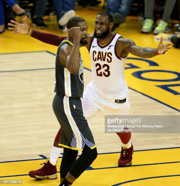 Cleveland Cavaliers' LeBron James reacts near Golden State Warriors' Kevin Durant after James was called for a technical foul during the third...
