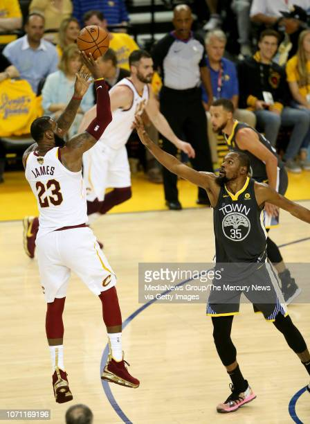 Cleveland Cavaliers' LeBron James shoots over Golden State Warriors' Kevin Durant during the third quarter of Game 2 of the NBA Finals at Oracle...