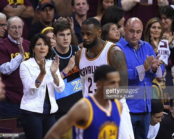 Cleveland Cavaliers LeBron James walks off the court in the final seconds as Golden State Warriors celebrate defeating the Cavaliers in Game 6 to win...