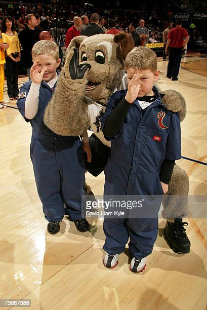 Cleveland Cavaliers mascot MoonDog and two young fans thumb their noses towards the opposing New York Knicks March 23, 2007 at The Quicken Loans...
