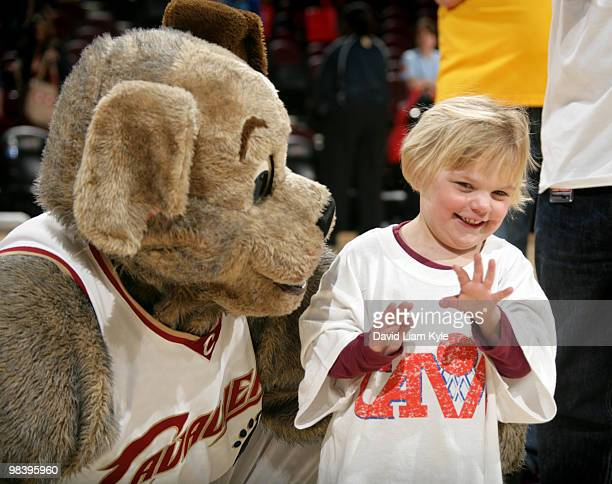 Cleveland Cavaliers mascot Moondog gives a young fan his jersey on Fan Appreciation Day after the game against the Orlando Magic on April 11, 2010 at...