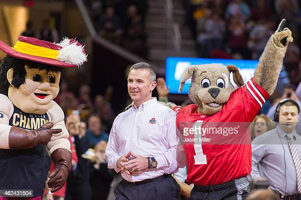 Cleveland Cavaliers mascots Sir CC and Moondog introduce Ohio State head football coach Urban Meyer during the first half between Cleveland Cavaliers...