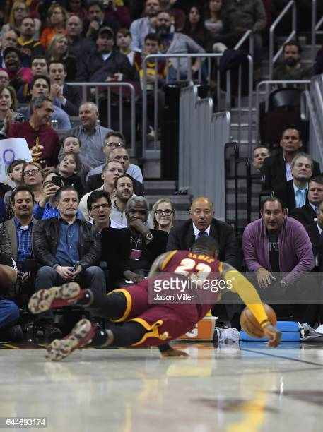 Cleveland Cavaliers owner Dan Gilbert and former NBA player Charles Oakley watch LeBron James of the Cleveland Cavaliers dive for the ball during the...