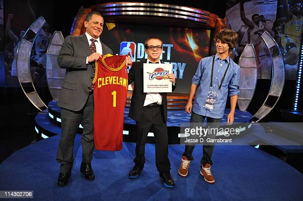 Cleveland Cavaliers owner Dan Gilbert and his two sons Nick and Grant celebrate after winning the number one overall pick in the 2011 NBA Draft at...
