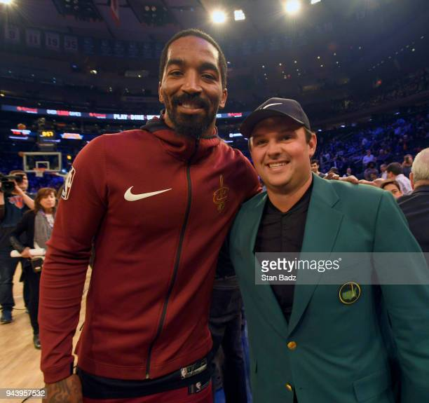 Cleveland Cavaliers player JR Smith and Masters Champion Patrick Reed pose for a photo at court side for the Cleveland Cavaliers and New York Knicks...