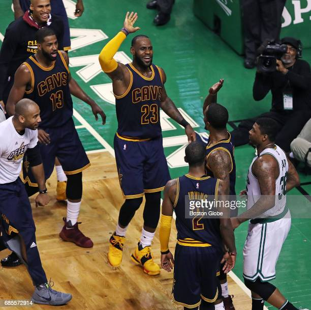 Cleveland Cavaliers player LeBron James high fives teammate JR Smith after Smith hit a buzzer beater to make the score 7231 at the end of the first...