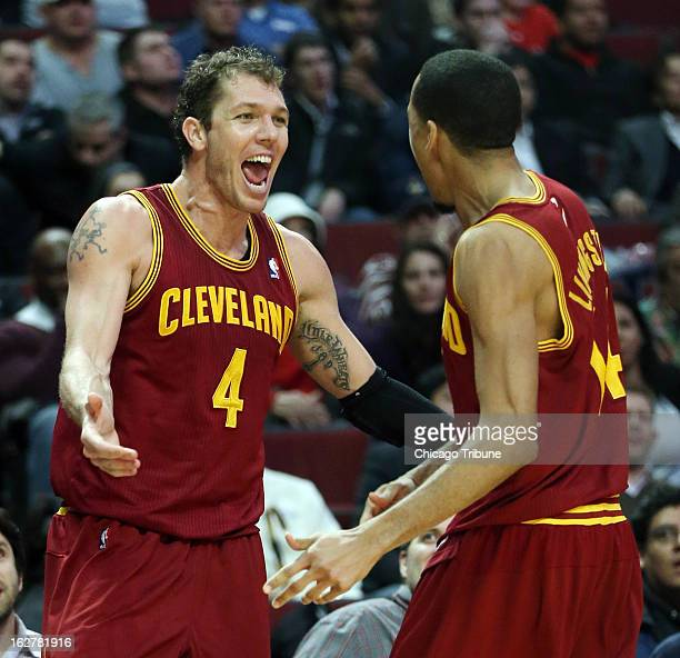 Cleveland Cavaliers small forward Luke Walton celebrates with teammate Shaun Livingston after Walton forced a turnover late in the fourth quarter...