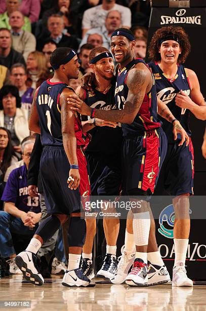Cleveland Cavaliers team mates Daniel Gibson Delonte West LeBron James and Anderson Varejao of the Cleveland Cavaliers celebrate a basket against the...