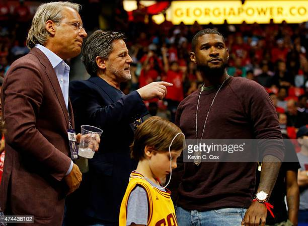 Cleveland Cavaliers Vice Chairman Nathan Forbes Majority Owner Dan Gilbert and part owner singer Usher attend Game Two of the Eastern Conference...