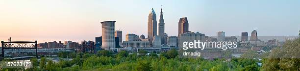 cleveland cityscape over cuyahoga river panorama - cleveland ohio stock photos and pictures