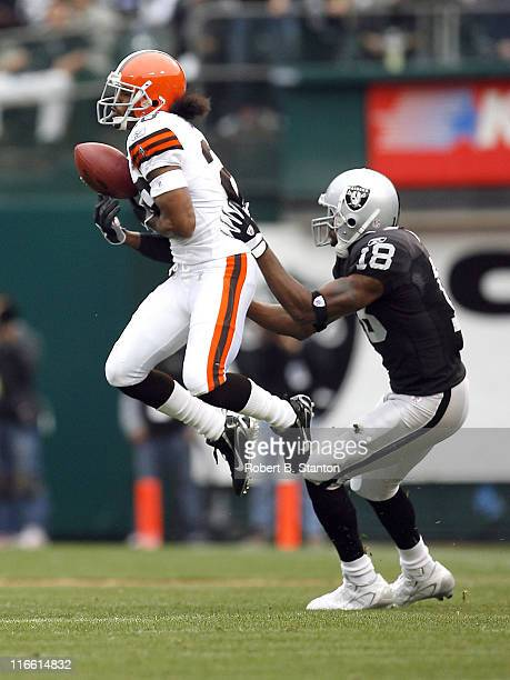 Cleveland cornerback Leigh Bodden steps in front of Oakland receiver Randy Moss to break up a pass in the second quarter as the Cleveland Browns...