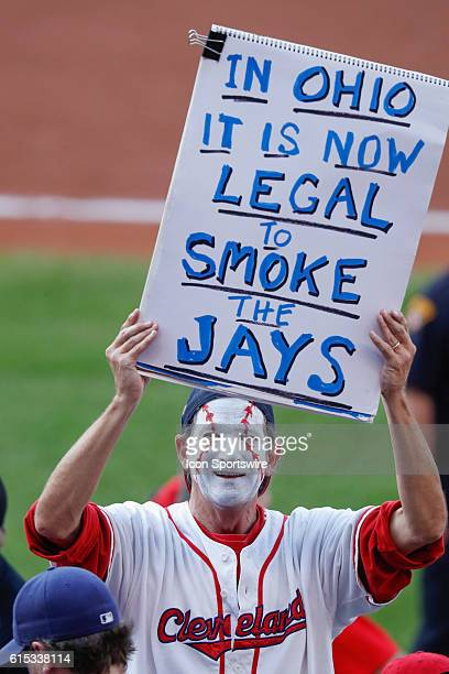 Cleveland fan holds up a sign during Game 2 of the American League Championship Series against the Toronto Blue Jays and the Cleveland Indians at...