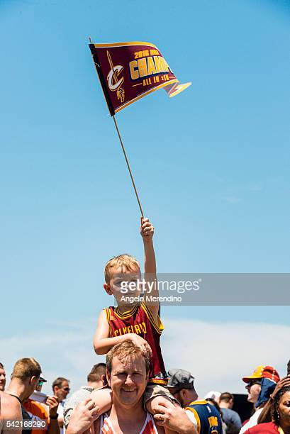 Cleveland fans celebrate during the Cleveland Cavaliers 2016 NBA Championship victory parade and rally on June 22, 2016 in Cleveland, Ohio. The...