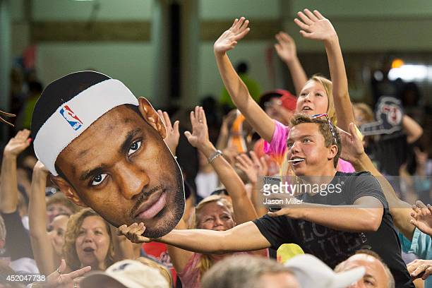 Cleveland fans mug for the scoreboard camera with a cutout of LeBron James during the sixth inning of the game between the Cleveland Indians and the...