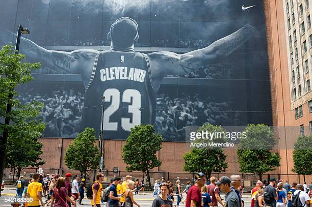 Cleveland fans walk in front of a LeBron James mural located on Ontario St during the Cleveland Cavaliers 2016 NBA Championship victory parade and...